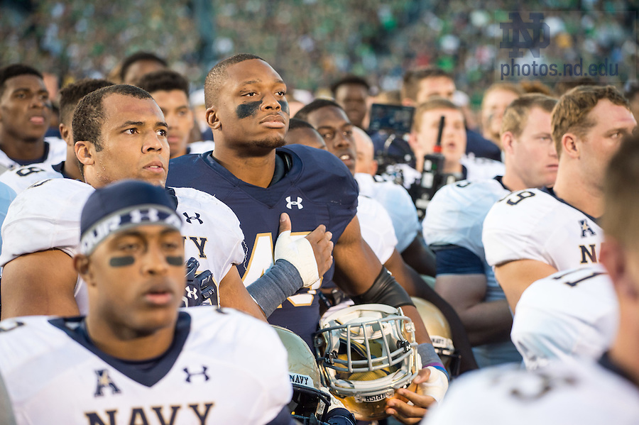Oct. 10, 2015; Notre Dame Fighting Irish defensive lineman Romeo Okwara (45) stands for the U.S. Naval Academy  Alma Mater following Notre Dame's 41-24 win at Notre Dame Stadium. (Photo by Matt Cashore)