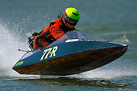 J. W. Myers races his late fathers runabout at Moses Lake, Wahington.
