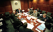 United States President George W. Bush leads his National Security Council in the Situation Room of the White House in Washington, DC on Friday morning, October 12, 2001. Pictured around the table starting at lower left: CIA Director George Tenet; White House Chief of Staff Andrew Card; US Vice President Dick Cheney; President Bush; US Secretary of State Colin Powell; US Secretary of Defense Donald Rumsfeld; Chairman of the Joint Chiefs of Staff General Richard Myers; and National Security Advisor Condoleezza Rice.  Not at the table at right is White House Counsel Alberto Gonzales.<br /> Mandatory Credit: Eric Draper / White House via CNP