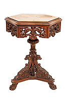BNPS.co.uk (01202 558833)<br /> Pic: SheldonCarpenter/Witherell'sInc/BNPS<br /> <br /> Pictured: Al and Mae Capone's decorative side table.<br /> <br /> An incredible treasure trove of Al Capone heirlooms have sold at auction for a whopping £2.3m. ($3.1m)<br /> <br /> The star lot was the notorious American gangster's favourite gun - a 1911 Colt semi-automatic pistol, which was expected to fetch £110,000 but sold for an incredible £764,000. ($1.04m)<br /> <br /> The remarkable collection, sold by his granddaughters, included personalised jewellery, photographs and furniture and a letter written to his only child Sonny from Alcatraz Prison, which showed a tender side to the ruthless crime boss.