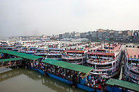 Bangladeshi people heading to their respective villages for the upcoming Muslim religious festival Eid-al-Adha. In order to catch a passenger ferry, they overcrowd harbors and ferries beyond imagination, climbing on roofs on any protrusion at their reach. Sadarghat launch terminal, Dhaka, Bangladesh. Oct. 4, 2014