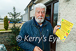 Councillor Johnnie Wall with the anti-vaccine leaflet which was delivered to his home.