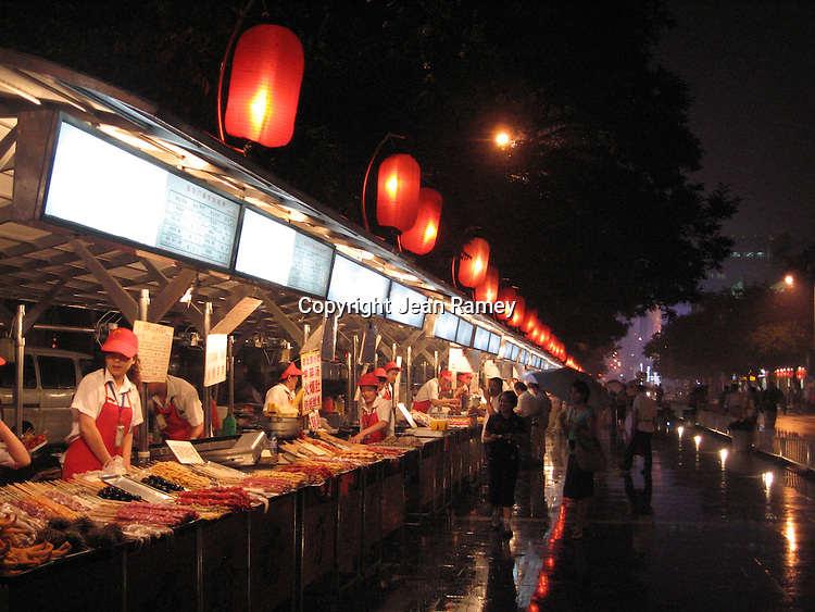 Donghuamen Night Market in Beijing is lined with red lanterns. Vendors sell  exotic delicacies such as scorpions and starfish, as well as traditional street market foods