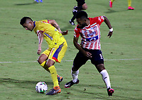 BARRANQUILLA-COLOMBIA, 07-10-2020: Miguel Angel Borja de Atletico Junior y Jerson Malagon de Deportivo Pasto disputan el balon, durante partido entre Atletico Junior y Deportivo Pasto, de la fecha 12 por la Liga BetPlay DIMAYOR 2020-I jugado en el estadio Romelio Martinez de la ciudad de Barranquilla. / Miguel Angel Borja of Atletico Junior and Jerson Malagon of Deportivo Pasto battle for the ball, during a match between Atletico Junior and Deportivo Pasto of the 12th date for the BetPlay DIMAYOR Leguaje 2020-I played at the Romelio Martinez Stadium in Barranquilla city. / Photo: VizzorImage / Jairo Cassiani / Cont.