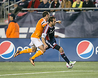 Houston Dynamo forward Brad Davis (11) tackles New England Revolution defender A.J. Soares (5) from behind.  The New England Revolution played to a 1-1 draw against the Houston Dynamo during a Major League Soccer (MLS) match at Gillette Stadium in Foxborough, MA on September 28, 2013.