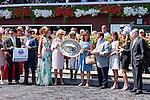 SARATOGA SPRINGS - AUGUST 27: Jockey Javier Castellano (C) for Cavorting #5 (not pictured) stands in the winner's circle with the connections after winning the the Personal Ensign Stakes on Travers Stakes Day at Saratoga Race Course on August 27, 2016 in Saratoga Springs, New York. (Photo by Sue Kawczynski/Eclipse Sportswire/Getty Images)
