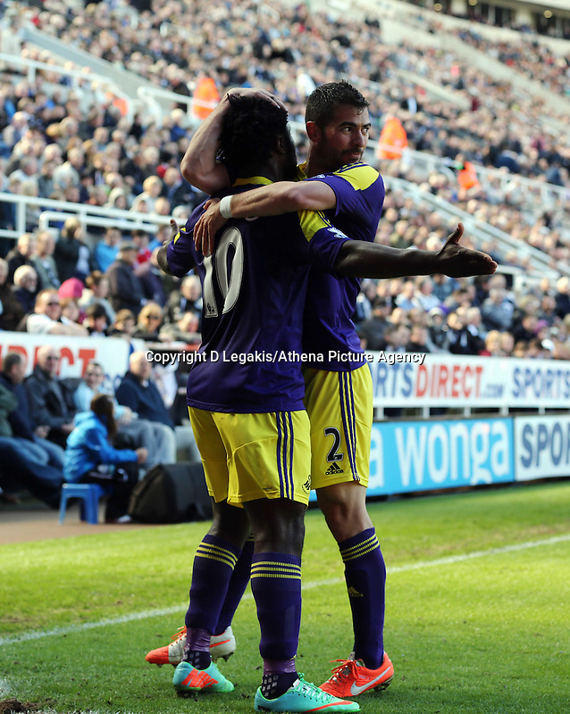 Pictured L-R: Wilfried Bony of Swansea celebrating his equaliser with team mate Jordi Amat. Saturday 19 April 2014<br /> Re: Barclay's Premier League, Newcastle United v Swansea City FC at St James Park, Newcastle, UK.