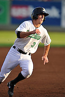 Andy Peterson #3 of the Clinton LumberKings rounds third base against the South Bend Silver Hawks at Ashford University Field on July 26, 2014 in Clinton, Iowa. The Sliver Hawks won 2-0.   (Dennis Hubbard/Four Seam Images)