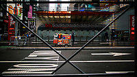 NEW YORK, NY - OCTOBER 20: A man pushes a food car in front of a closed theater ticket business in Times Square on October 20, 2020 in New York, with more than a 72% decline in tourism activity since the spread of the pandemic. Hotels, restaurants, museums, are more affected across New York State.  (Photo by Eduardo MunozAlvarez/VIEWpress)