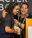 Ariel DeLeon, left, and her mother react after she won two tickets to Super Bowl LI during the Houston launch of the Character Playbook, a joint initiative of the NFL and the United Way Worldwide at Pilgrim Academy, February 3, 2017.