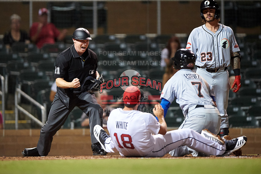 Home plate umpire Junior Valentine calls Glendale Desert Dogs Omar Estevez (7) out after being tagged by Scottsdale Scorpions relief pitcher Brandon White (18) during an Arizona Fall League game on September 20, 2019 at Salt River Fields at Talking Stick in Scottsdale, Arizona. Scottsdale defeated Glendale 3-2. (Zachary Lucy/Four Seam Images)