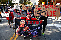 Protestors and Trump supporters gather outside of the David L. Lawrence Convention Center near the intersection of 10th Street and Penn Avenue while President Trump speaks nearby at a natural gas convention on Wednesday October 23, 2019 in Pittsburgh, Pennsylvania. (Photo by Jared Wickerham/Pittsburgh City Paper)
