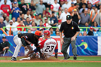 11 March 2009: #23 Jesus Feliciano of Puerto Rico slides safely at third as #2 Yurendell DeCaster of the Netherlands tags him during the 2009 World Baseball Classic Pool D game 6 at Hiram Bithorn Stadium in San Juan, Puerto Rico. Puerto Rico wins 5-0 over the Netherlands