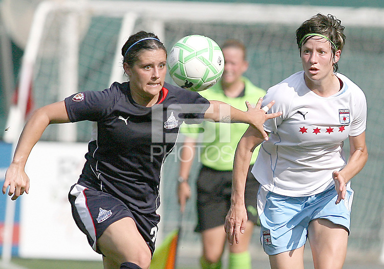 Allie Krieger #27 of Washington Freedom pushes off on Megan Rapinoe #8 of the Chicago Red Stars during a WPS match at RFK stadium on June 13 2009 in Washington D.C. The game ended in a 0-0 tie.
