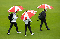 The officials complete with umbrellas cross the pitch during India vs New Zealand, ICC World Test Championship Final Cricket at The Hampshire Bowl on 21st June 2021