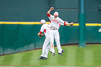 Landon Appling #1, Kyle Survance #34 and Ashford Fulmer #23 celebrate following their win over the Texas Tech Red Raiders at Minute Maid Park on February 28, 2014 in Houston, Texas.  The Cougars defeated the Red Raiders 9-0.  (Brian Westerholt/Four Seam Images)