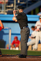 Umpire Jacob Dallas makes a calling during a NY-Penn League game between the Batavia Muckdogs and Mahoning Valley Scrappers at Dwyer Stadium on August 22, 2012 in Batavia, New York.  Batavia defeated Mahoning Valley 3-2.  (Mike Janes/Four Seam Images)