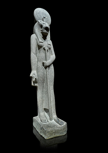 """Ancient Egyptian statue of goddess Sekhmet, grandodiorite, New Kingdom, 18th & 20thDynasty (1156-1150 BC), Thebes. Egyptian Museum, Turin. black background.<br /> <br /> Sekhmet, """"the Powerful One"""" was a fearsome goddess symbolised by her lioness head. Daughter of the sun she personifies the disk of the world during the day. Sekhmet is the angry manifestation of Hathor inflicting the scourges of summer heat, famine and illness which is why the goddess needed to be exorcised every day. Drovetti Collection. C 251"""