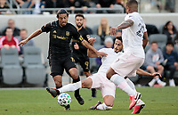LOS ANGELES, CA - MARCH 01: Carlos Vela #10 of LAFC and Nicolas Figal #5 of Inter Miami CF chase after ball during a game between Inter Miami CF and Los Angeles FC at Banc of California Stadium on March 01, 2020 in Los Angeles, California.