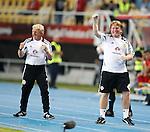 Gordon Strachan and Stuart McCall celebrate as Shaun Maloney's free-kick winner hits the back of the net
