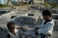 Haitian children play in the slum of Cité Soleil, Port-au-Prince, Haiti, 21 July 2008. Cité Soleil is considered one of the worst slums in the Americas, most of its 300.000 residents live in extreme poverty. Children and single mothers predominate in the population. Social and living conditions in the slum are a human tragedy. There is no running water, no sewers and no electricity. Public services virtually do not exist - there are no stores, no hospitals or schools, no urban infrastructure. In spite of this fact, a rent must be payed even in all shacks made from rusty metal sheets. Infectious diseases are widely spread as garbage disposal does not exist in Cité Soleil. Violence is common, armed gangs operate throughout the slum.