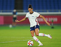 YOKOHAMA, JAPAN - JULY 30: Christen Press #11 of the United States shoots the ball during a game between Netherlands and USWNT at International Stadium Yokohama on July 30, 2021 in Yokohama, Japan.