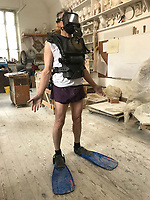 BNPS.co.uk (01202 558833)<br /> Pic: MarkRichards/BNPS<br /> <br /> The Royal Navy sent some authentic diving equipment to Mark's studio near Ludlow for modelling.<br /> <br /> The fine art of surfacing -  Artist Mark Richards has gone to extraordinary lengths to create a lifelike 'floating' sculpture in tribute to Royal Navy mine and bomb clearance divers to be installed at Gunwharf Quays in Portsmouth next year.<br /> <br /> In an attempt to replicate the feeling of being submerged Mark suspended himself with ropes and pulleys, photographed a Navy drysuit in a local swimming pool, and reproduced in minute detail all the equipment used by brave service personnel in their perilous work.<br /> <br /> The completed sculpture will now be scaled up to 1.25 life size and cast in bronze at Morris Singer foundry in Hampshire.