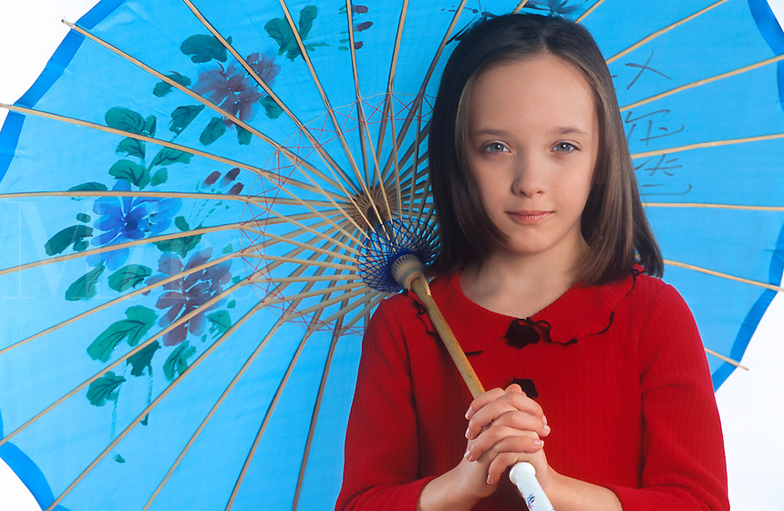Young girl with parasol umbrella.