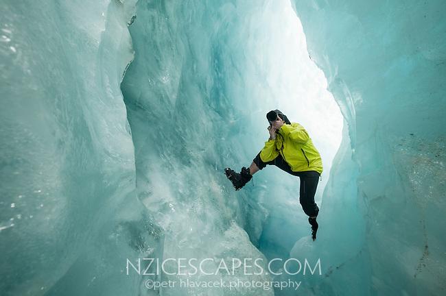 Photographer photographing on Franz Josef Glacier, Westland National Park, West Coast, World Heritage Area, New Zealand