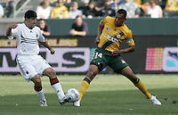 Tyone Marshall, LA Galaxys Captain, battles for the ball against DC Uniteds Alecko Eskandarian. The Galaxy tied DC United 1-1 during a MLS game at The Home Depot Center in Carson, California Sunday June 11, 2006.