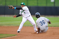 Martin Peguero #7 of the Clinton LumberKings takes a catchers throw at second base against the West Michigan Whitecaps at Ashford University Field on July  25, 2014 in Clinton, Iowa. The Whitecaps won 9-0.   (Dennis Hubbard/Four Seam Images)