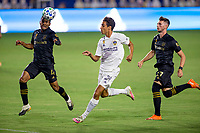 CARSON, CA - SEPTEMBER 06: Team mates Eddie Segura #4 & Tristan Blackmon #27 of LAFC chase down a loose ball with Ethan Zubak #29 of Los Angeles Galaxy during a game between Los Angeles FC and Los Angeles Galaxy at Dignity Health Sports Park on September 06, 2020 in Carson, California.