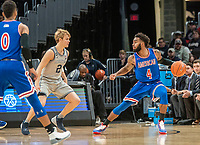 WASHINGTON, DC - DECEMBER 28: Jamir Harris #4 of American holds the ball away from Mac McClung #2 of Georgetown during a game between American University and Georgetown University at Capital One Arena on December 28, 2019 in Washington, DC.