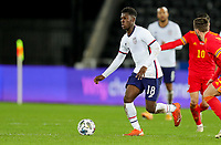 SWANSEA, WALES - NOVEMBER 12: Yunus Musah #18 of the United States moves forward with the ball during a game between Wales and USMNT at Liberty Stadium on November 12, 2020 in Swansea, Wales.