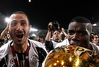 Calcio, finale Tim Cup: Milan vs Juventus. Roma, stadio Olimpico, 21 maggio 2016.<br /> Juventus' Giorgio Chiellini, left, and Paul Pogba celebrate with the trophy at the end of the Italian Cup final football match between AC Milan and Juventus at Rome's Olympic stadium, 21 May 2016. Juventus won 1-0 in the extra time.<br /> UPDATE IMAGES PRESS/Isabella Bonotto