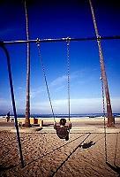 Boy playing on swings<br />