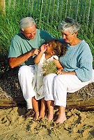 Grandparents share quality time with grandchild at the beach, Cape Cod, MA