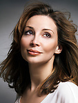Portrait of a beautiful smiling caucasian woman with brown hair with daydreaming expression in her thirties Image © MaximImages, License at https://www.maximimages.com