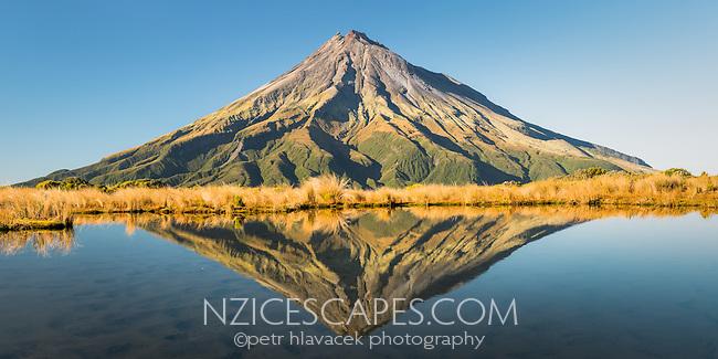 Taranaki, Mt. Egmont with reflections in alpine tarn, Egmont National Park, North Island, New Zealand, NZ