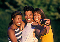 Young adults taking a picture of themselves.