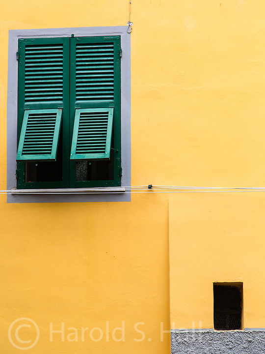 The bright colors and window shutters of Italy can form modern cube designs.  Most of these types of windows also have access to the family clothes line.