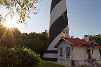 The historic St. Augustine lighthouse on Anastasia Island photographed just before sunset.