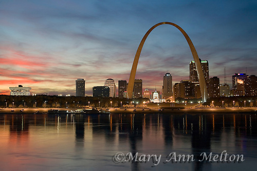 St. Louis skyline  and Gateway Arch reflected in the Mississippi River . at sunset.St. Louis, Gateway Arch,
