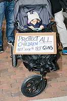 "A sign on a baby stroller reads ""Protect all children / Not some & not guns"" as people take part in the March For Our Lives protest, walking from Roxbury Crossing to Boston Common, in Boston, Massachusetts, USA, on Sat., March 24, 2018, in response to recent school gun violence."