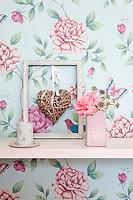 Graham & Brown floral print wallpaper adorns the walls of the living room