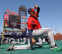 Washington Nationals pitcher Tony Aramas stretches during warm-ups prior to the  opening day game against the Philadelphia Phillies in Philadelphia, March 29, 2005.  REUTERS/Bradley Bower