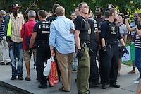 """Kundgebung gegen Polizeikontrollen im Goerlitzer Park in Berlin-Kreuzberg.<br />Ca. 150 Menschen protestierten am Donnerstag den 1. August 2013 in Berlin-Kreuzberg gegen die ihrer Meinung nach rassistischen Drogenkontrollen im Goerlitzer Park, bei denen die Polizei gezielt gegen Menschen mit dunkler Haut vorgeht. Dabei kommt es immer wieder zu rassistischen Ausfaellen von Seiten der Polizei und etliche Menschen wurden bei diesen Kontrollen von der Polizei verletzt. Drogen wurden bei den Kontrollen nur in geringem Masse beschagnahmt.<br />Menschen mit heller Haut werden von der Polizei nicht kontrolliert.<br />Die Kundgebungsteilnehmer forderten ein Ende dieses sog. """"Racial Profiling"""".<br />Im Bild: Die Polizei eskortiert einen Anwohner von der Kundgebung weg, der sich laustark gegen die Kundgebung ausgesprochen hat und die Polizeieinsaetze im Goerlitzer Park begruesst hat.<br />1.8.2013, Berlin<br />Copyright: Christian-Ditsch.de<br />[Inhaltsveraendernde Manipulation des Fotos nur nach ausdruecklicher Genehmigung des Fotografen. Vereinbarungen ueber Abtretung von Persoenlichkeitsrechten/Model Release der abgebildeten Person/Personen liegen nicht vor. NO MODEL RELEASE! Don't publish without copyright Christian-Ditsch.de, Veroeffentlichung nur mit Fotografennennung, sowie gegen Honorar, MwSt. und Beleg. Konto:, I N G - D i B a, IBAN DE58500105175400192269, BIC INGDDEFFXXX, Kontakt: post@christian-ditsch.de<br />Urhebervermerk wird gemaess Paragraph 13 UHG verlangt.]"""