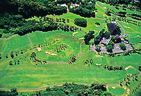 Aerial shot inside Punchbowl National Cemetery on Oahu. Also shows the lush green side of Punchbowl Crater in foreground.