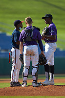 Atlanta Braves scout xxx has a meeting on the mound with pitcher Kenya Huggins, Jr (26) of St Augustine HS in Avondale, LA and catcher Blaise Priester (10) of Live Oak, HS in Denham Springs, LA during the East Coast Pro Showcase at the Hoover Met Complex on August 5, 2020 in Hoover, AL. (Brian Westerholt/Four Seam Images)