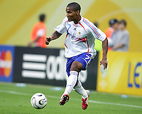 Florent Malouda (7) of France. The Korea Republic and France played to a 1-1 tie in their FIFA World Cup Group G match at the Zentralstadion, Leipzig, Germany, June 18, 2006.